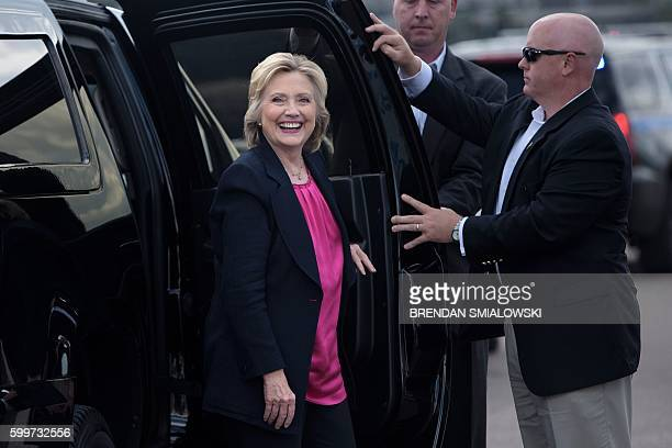 Democratic presidential nominee Hillary Clinton arrives to board her plane at Tampa International Airport September 6 2016 in Tampa Florida / AFP /...