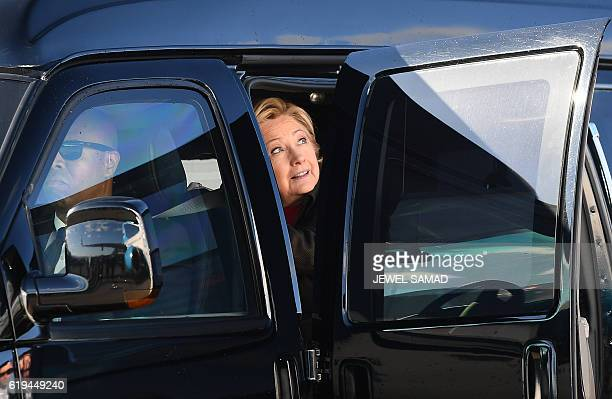 US Democratic presidential nominee Hillary Clinton arrives to board her campaign plane at the Westchester County Airport in White Plains New York on...