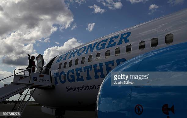 Democratic presidential nominee Hillary Clinton boards her campaign plane at Tampa International Airport on September 6 2016 in Tampa Florida Clinton...