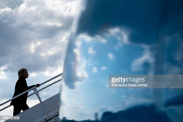 TOPSHOT Democratic presidential nominee Hillary Clinton boards her plane at Tampa International Airport September 6 2016 in Tampa Florida / AFP /...