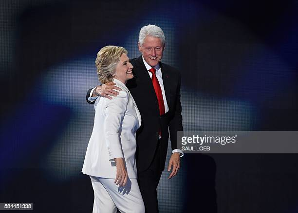 Democratic presidential nominee Hillary Clinton celebrates on stage with husband former US president Bill Clinton on the fourth and final night of...