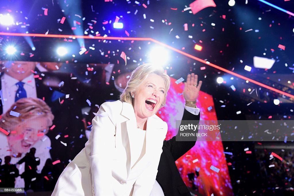 TOPSHOT - Democratic presidential nominee Hillary Clinton celebrates on stage after she accepted the nomination during the fourth and final night of the Democratic National Convention at the Wells Fargo Center, July 28, 2016 in Philadelphia, Pennsylvania. / AFP / Robyn Beck