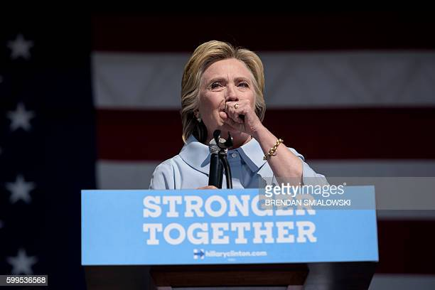 Democratic presidential nominee Hillary Clinton coughs during a Labor Day rally September 5 2016 in Cleveland Ohio Hillary Clinton launched the home...