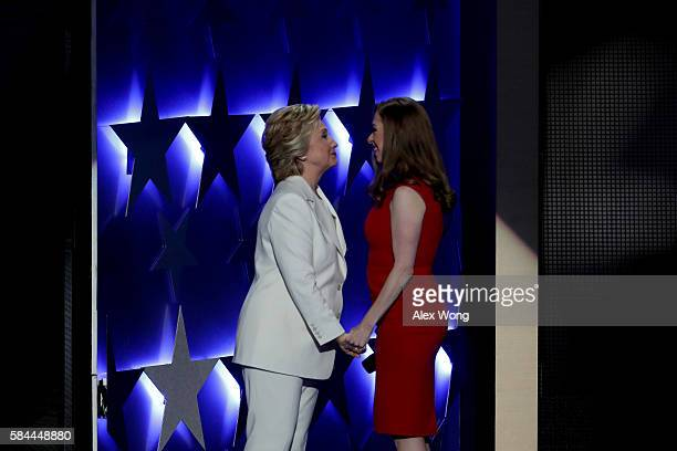 Democratic presidential nominee Hillary Clinton embraces her daughter Chelsea Clinton after being introduced on the fourth day of the Democratic...