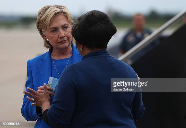 Democratic presidential nominee Hillary Clinton greets a supporter after walking off of her campaign plane at Charles B Wheeler Downtown Airport on...