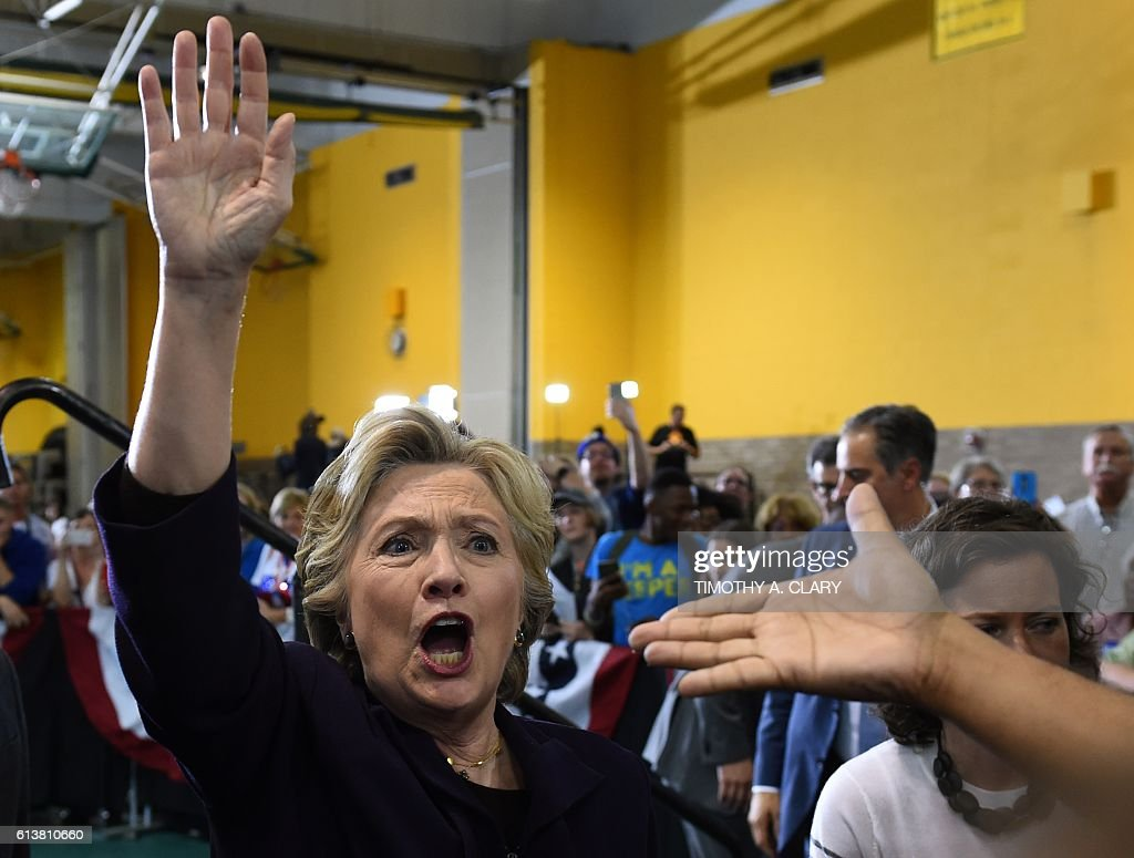TOPSHOT - Democratic presidential nominee Hillary Clinton greets attendees at a rally at Wayne State University in Detroit, Michigan October 10, 2016. / AFP / TIMOTHY