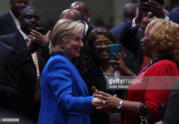 Democratic presidential nominee Hillary Clinton greets attendees during the 136th annual session of the National Baptist Convention on September 8...