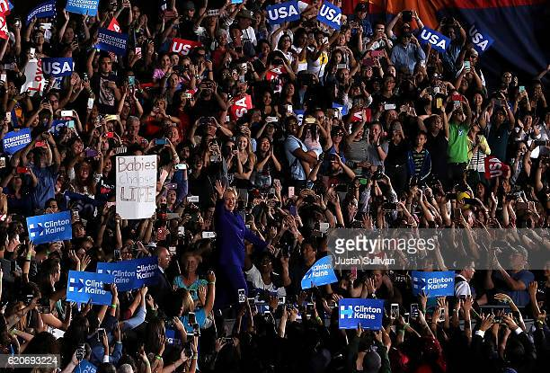 Democratic presidential nominee Hillary Clinton greets supporters during a campaign rally at Arizona State University on November 2 2016 in Tempe...