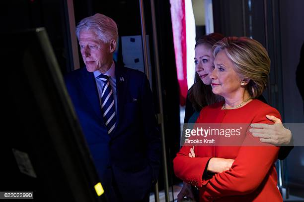 Democratic presidential nominee Hillary Clinton her husband former President Bill Clinton and daughter Chelsea watch Lady Gaga perform on a monitor...