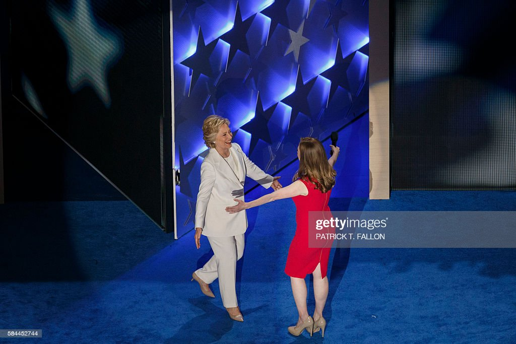 Democratic presidential nominee Hillary Clinton hugs her daughter Chelsea Clinton as she walks on stage to accept her nomination during the fourth and final night of the Democratic National Convention at Wells Fargo Center on July 28, 2016 in Philadelphia, Pennsylvania. / AFP / Patrick T. Fallon