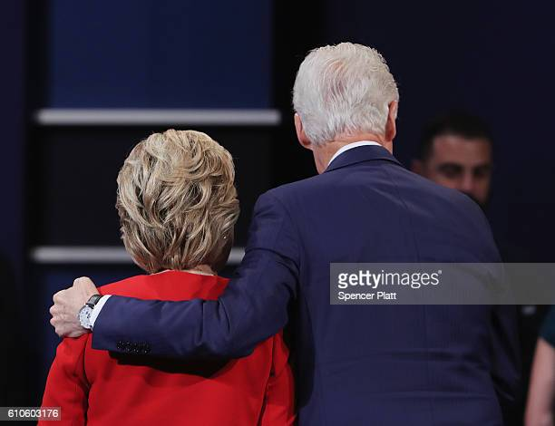 Democratic presidential nominee Hillary Clinton hugs husband and former US President Bill Clinton after the Presidential Debate with Republican...