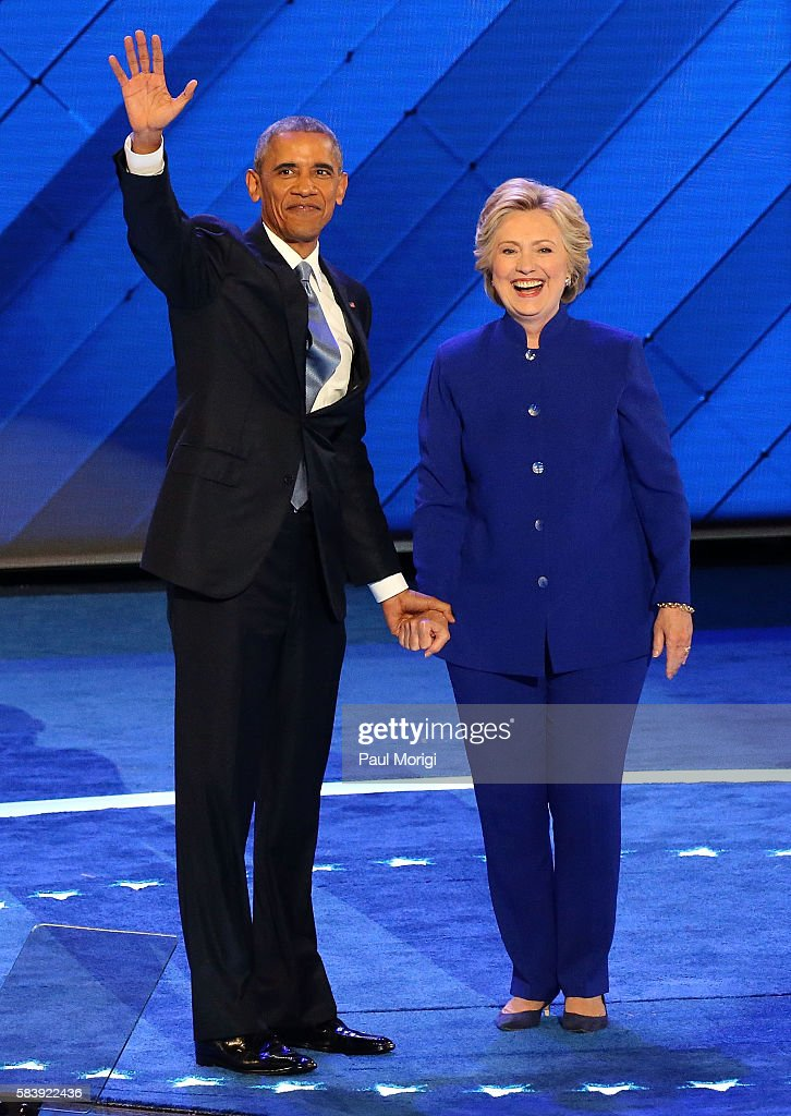 Democratic Presidential nominee Hillary Clinton joins U.S. President Barack Obama onstage on the third day of the Democratic National Convention at the Wells Fargo Center on July 27, 2016 in Philadelphia, Pennsylvania. An estimated 50,000 people are expected in Philadelphia, including hundreds of protesters and members of the media. The four-day Democratic National Convention kicked off July 25.