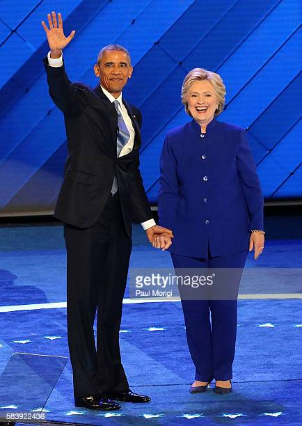 Democratic Presidential nominee Hillary Clinton joins U.S. President Barack Obama onstage on the third day of the Democratic National Convention at...