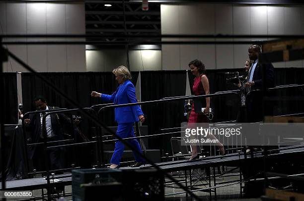 Democratic presidential nominee Hillary Clinton leaves the stage after speaking at the 136th annual session of the National Baptist Convention on...