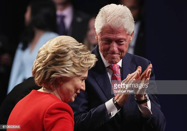 Democratic presidential nominee Hillary Clinton looks on with husband and former US President Bill Clinton after the Presidential Debate with...