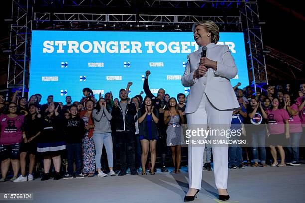 Democratic presidential nominee Hillary Clinton pauses while speaking to supporters at Craig Ranch Regional Park Amphitheater after the final...