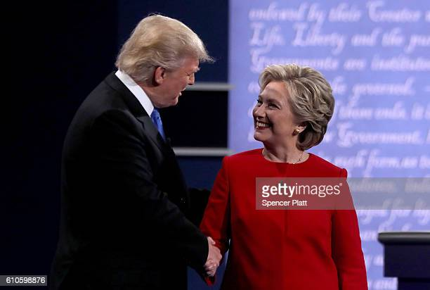 Democratic presidential nominee Hillary Clinton shakes hands with Republican presidential nominee Donald Trump during the Presidential Debate at...