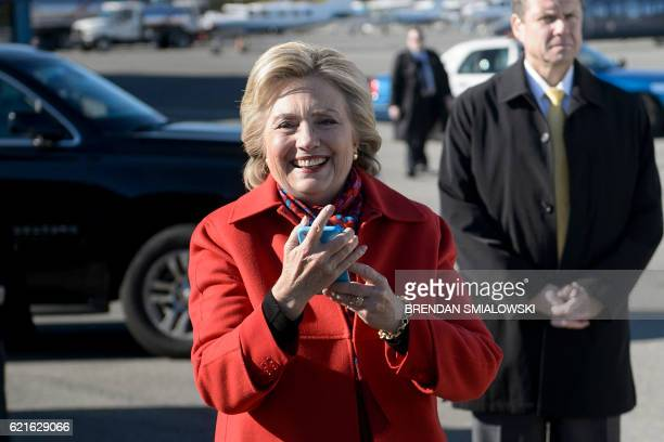 Democratic presidential nominee Hillary Clinton smiles after using her phone to video chat with her granddaughter Charlotte Clinton Mezvinsky before...