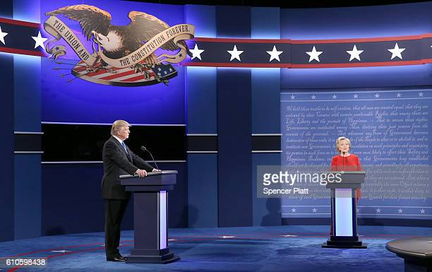 Democratic presidential nominee Hillary Clinton speaks as Republican presidential nominee Donald Trump listens during the Presidential Debate at...