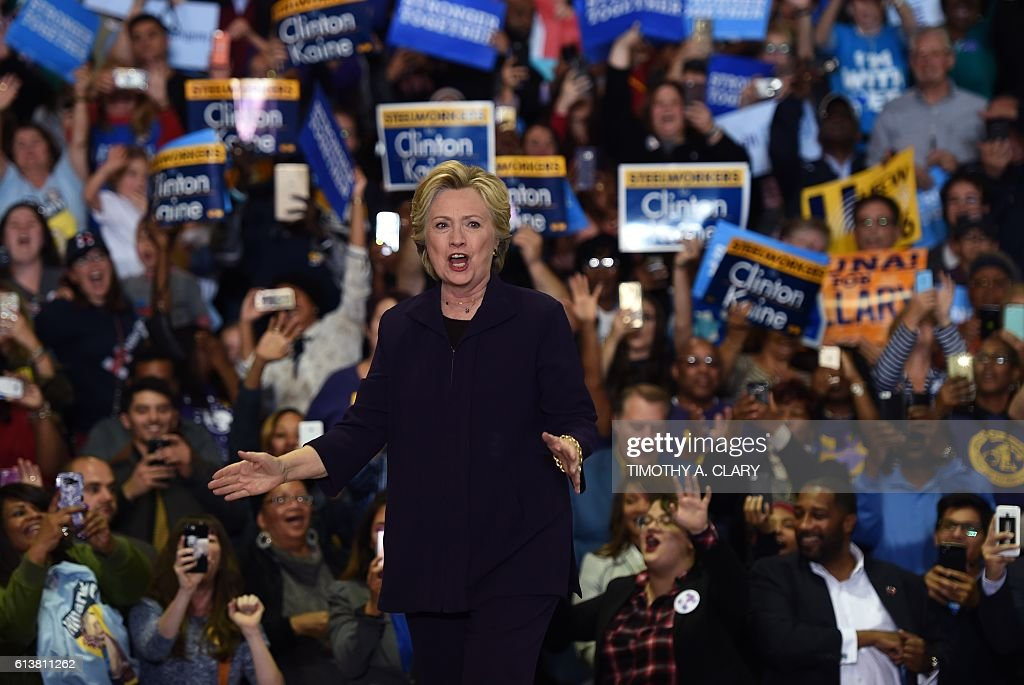 Democratic presidential nominee Hillary Clinton speaks during a rally at Wayne State University in Detroit, Michigan October 10, 2016. / AFP / TIMOTHY