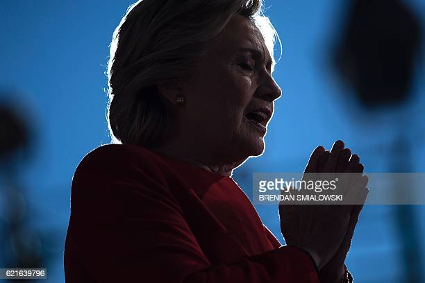Democratic presidential nominee Hillary Clinton speaks during a rally outside the University of Pittsburgh's Cathedral of Learning November 7, 2016...