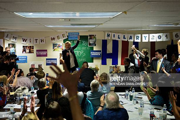 Democratic presidential nominee Hillary Clinton speaks to supporters at one of her campaign field offices on October 13 in San Francisco California /...