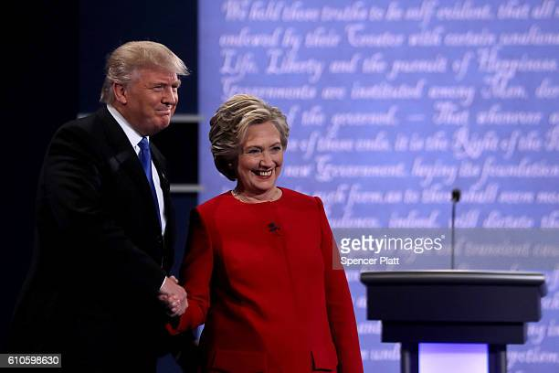 Democratic presidential nominee Hillary Clinton takes the stage with Republican presidential nominee Donald Trump during the Presidential Debate at...