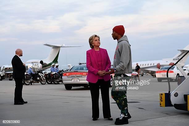 US Democratic presidential nominee Hillary Clinton talks with singer Pharrell Williams in Morrisville North Carolina North Carolina on November 3...