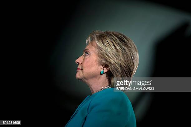 Democratic presidential nominee Hillary Clinton waits to speak during a rally at the Armory November 6 2016 in Manchester New Hampshire / AFP /...