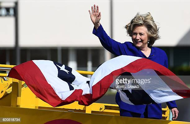 Democratic presidential nominee Hillary Clinton waves before boarding her campaign plane in Fort Lauderdale, Florida, on November 2, 2016. / AFP /...