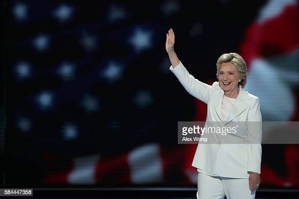Democratic presidential nominee Hillary Clinton waves to the crowd as she arrives on stage during the fourth day of the Democratic National...