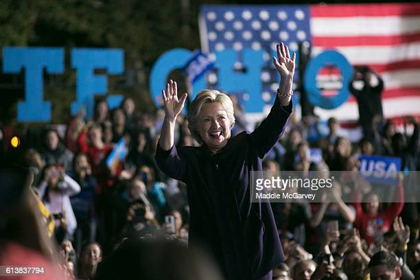 Democratic presidential nominee Hillary Clinton waves to the crowd after speaking at Ohio State University on October 10 2016 in Columbus Ohio A day...