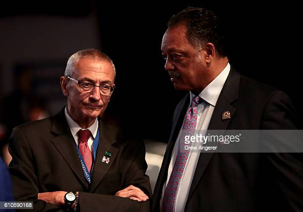 Democratic presidential nominee Hillary Clinton's Campaign Chairman John Podesta talks with with Rev Jesse Jackson prior to the start of the...