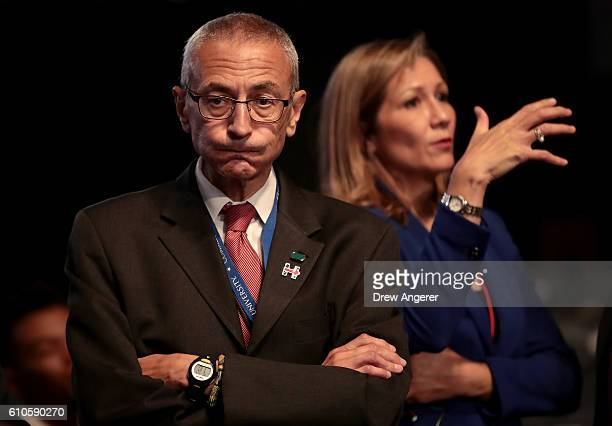 Democratic presidential nominee Hillary Clinton's Campaign Chairman John Podesta looks on prior to the start of the Presidential Debate at Hofstra...