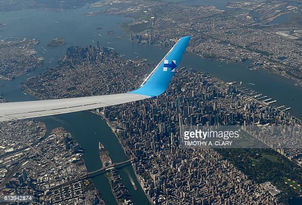 TOPSHOT Democratic presidential nominee Hillary Clinton's plane passes over Manhattan October 11 2016 as she departs New York enroute to a climate...