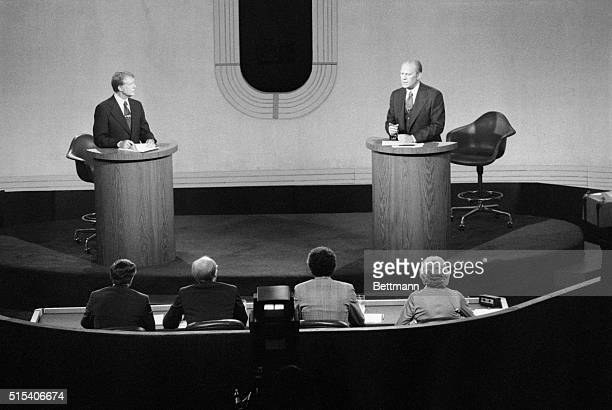 Democratic presidential nominee Jimmy Carter and President Jerry Ford shown before panel during second debate at San Francisco's Palace of Fine Arts...