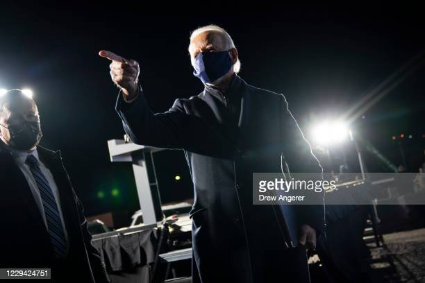 Democratic presidential nominee Joe Biden acknowledges supporters after speaking during a drive-in campaign rally at Lexington Technology Park on...