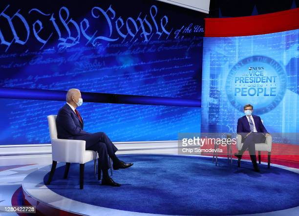 Democratic presidential nominee Joe Biden and ABC News Chief Anchor George Stephanopoulos pose for photographs at the beginning of a town hall format...