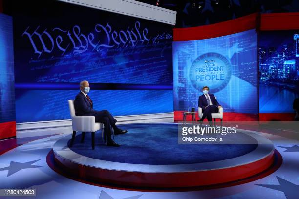Democratic presidential nominee Joe Biden and ABC News Chief Anchor George Stephanopoulos pose for photographs at the conclusion of a town hall...