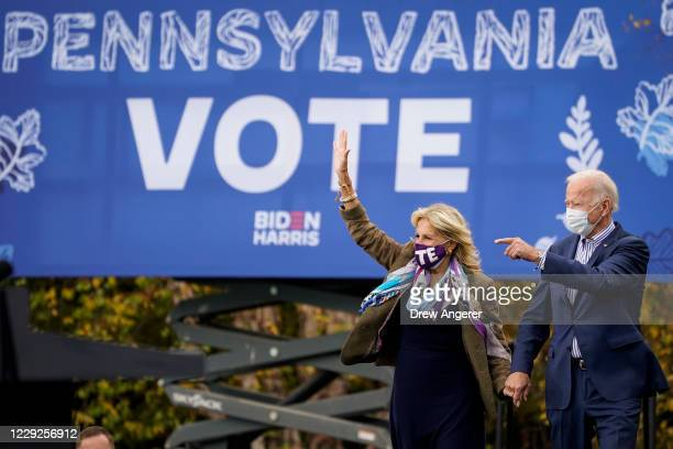 Democratic presidential nominee Joe Biden and his wife Dr. Jill Biden arrive for a drive-in campaign rally at Bucks County Community College on...