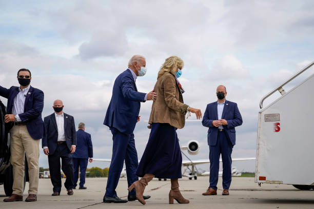Democratic presidential nominee Joe Biden and his wife Dr Jill Biden board the campaign plane at Philadelphia International Airport for a flight to...