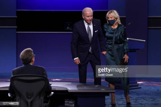 Democratic presidential nominee Joe Biden and his wife Jill Biden speak to debate moderator Chris Wallace after the first presidential debate against...