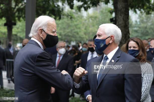 Democratic presidential nominee Joe Biden and U.S. Vice President Mike Pence greet each other during a 9/11 memorial service at the National...