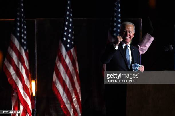 Democratic presidential nominee Joe Biden and wife Jill Biden arrive onstage to address supporters during election night at the Chase Center in...
