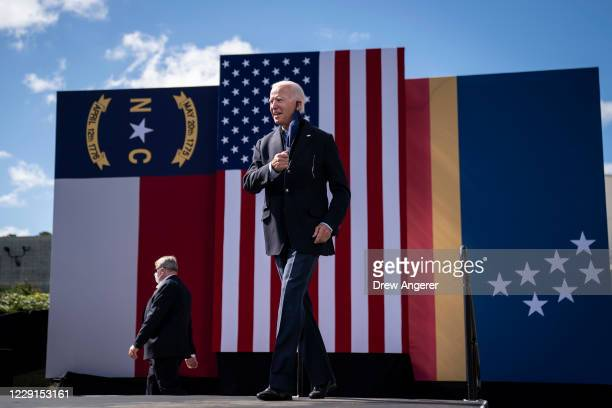 Democratic presidential nominee Joe Biden arrives to speak at a drive-in campaign rally at Riverside High School on October 18, 2020 in Durham, North...