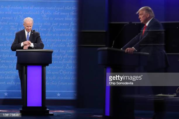 Democratic presidential nominee Joe Biden checks his watch during the final presidential debate against U.S. President Donald Trump at Belmont...