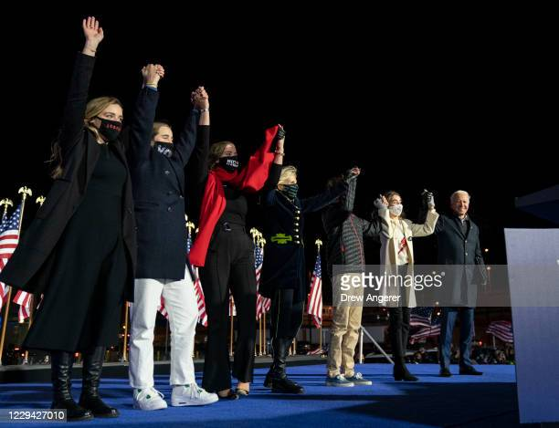 Democratic presidential nominee Joe Biden, Dr. Jill Biden and their grandchildren take the stage at the end of a drive-in campaign rally at Heinz...