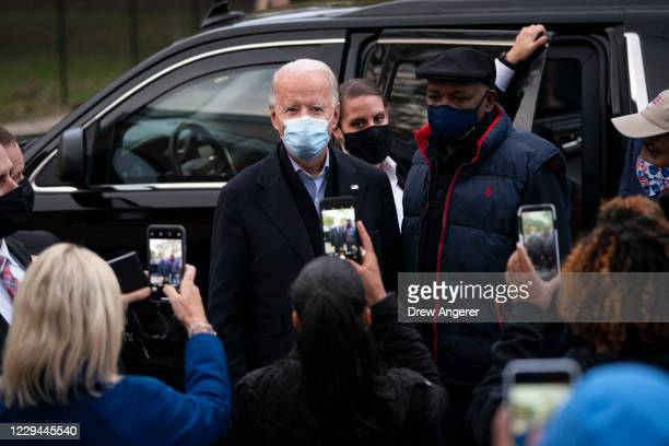 Democratic presidential nominee Joe Biden greets residents as he makes a stop near the Joseph R. Biden Jr. Aquatic Center, where he was the only...
