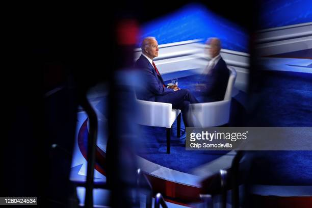 Democratic presidential nominee Joe Biden prepares for a live ABC News town hall format meeting at the National Constitution Center October 15, 2020...