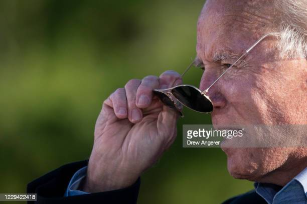 Democratic presidential nominee Joe Biden puts on his sunglasses while speaking at a campaign stop at Community College of Beaver County on November...